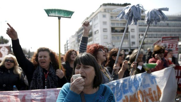 Protesting cleaning staff fired by the finance ministry marched holding up buckets and mops during a rally outside the Greek parliament in central Athens on 12 March 2014.