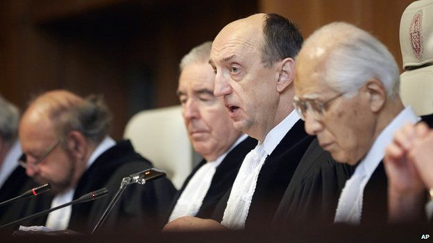 Judge Peter Tomka, centre, president of the International Court of Justice, delivers its verdict in The Hague, Netherlands, 31 March 2014