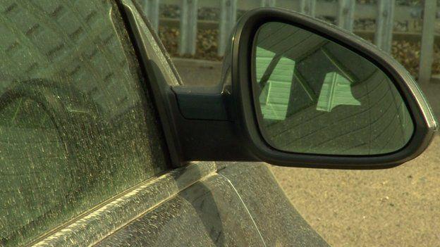Pollution dust on a car