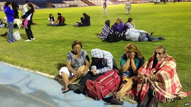 Locals take refuge at the city stadium in Iquique, Chile, on 1 April 2014
