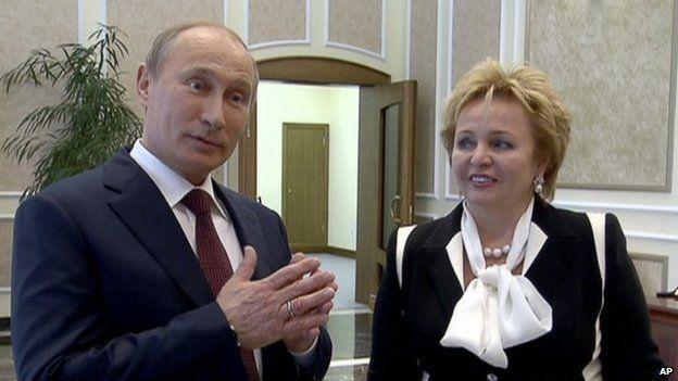 Russian President Vladimir Putin, left, and his wife Lyudmila speak to journalists on Russian TV, June 2013