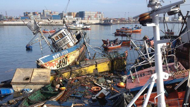 Sunken fishing boats in Iquique, northern Chile, on 2 April 2014