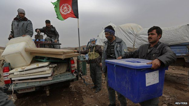 Afghan election commission workers load ballot boxes on a car at Ghori village at the Adraskan district of Herat Province on 3 April 2014.