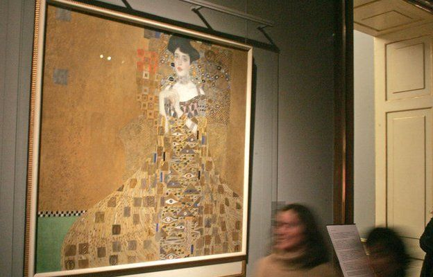 Gustav Klimt's portrait of Adele Bloch-Bauer on the wall of a gallery