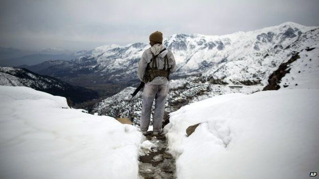 Photo by Anja Niedringhaus of a Pakistani soldier in Dir province on the border with Afghanistan, in February 2012