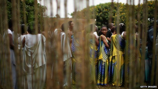 Dressed in traditional gowns, women line up before marching to commemorate the genocide of 1994 at the Kicukiro College of Technology football pitch on 5 April 2014 in Kigali, Rwanda.
