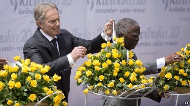 Former British Prime Minister Tony Blair, left, and Former South African President Thabo Mbeki, right, lay a memorial wreath at a ceremony in Kigali to mark the 20th anniversary of the Rwandan genocide (7 April 2014)