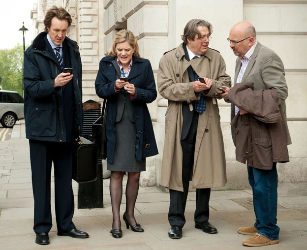 Phil Smith (Will Smith), Emma Messinger (Olivia Poulet), Peter Mannion MP (Roger Allam), Stewart Pearson (Vincent Franklin) in the Thick of It, Season Five.