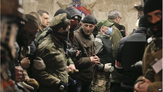 Pro-Russian activists occupy the regional police office in Donetsk, April 12