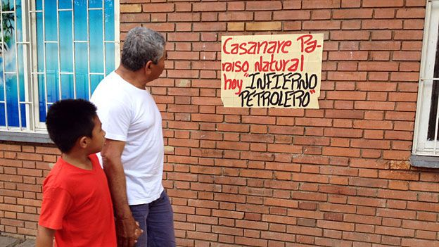 """Sign reading """"Casanare: natural paradise, now petroleum hell"""" in Casanare"""