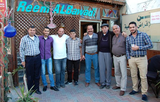 Eight men in the Talgieh family stand outside a cafe - The members of the Thalgieh family outside Reem al-Bawadi coffee shop - known locally as Abu George coffee shop. All the men in the picture are called George or Abu George (father of George as their oldest son is called George). George Elias Saba Thalgieh is second from right, George Nabil George Thalgieh is second from left. You actually have all the interesting comments they made that I recorded included in the feature. The older George also called his son, Khadr, the Arabic variant. He was having brain surgery when his wife was pregnant and promised St George he would name his son after him if he would give him protection. Mrs Thalgieh said it was confusing to have a husband and son called George so they settled on Khadr. The older George, George Elias Saba Thalgieh also told me he was called George as his birthday falls on 23rd April.
