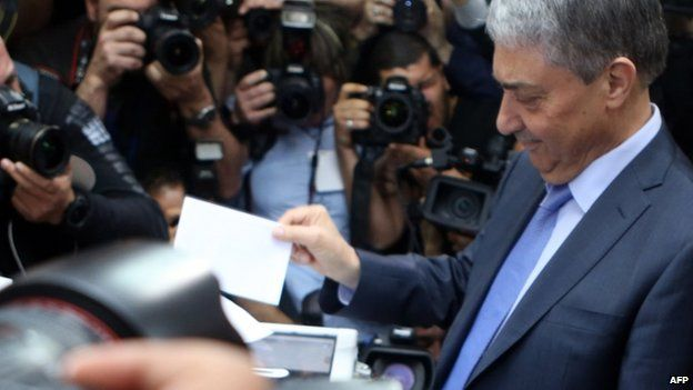 Ali Benflis, opposition leader and main rival to Algerian President Abdelaziz Bouteflika, casts his vote in the presidential elections at a polling station in Algiers on 17 April 2014