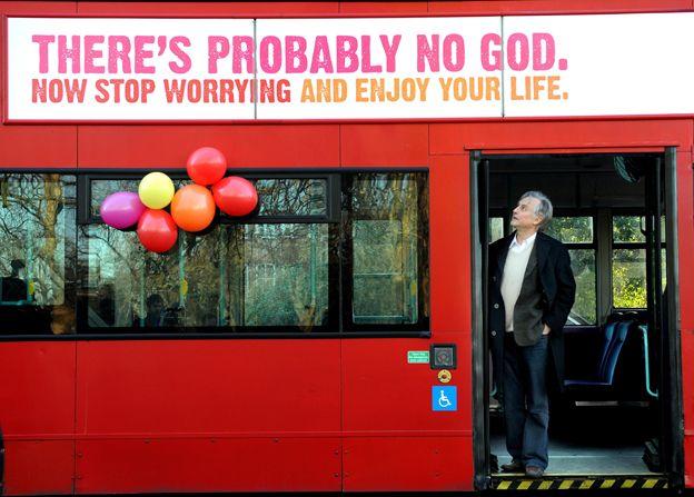 "Richard Dawkins on bus displaying sign saying ""There's probably no God"""
