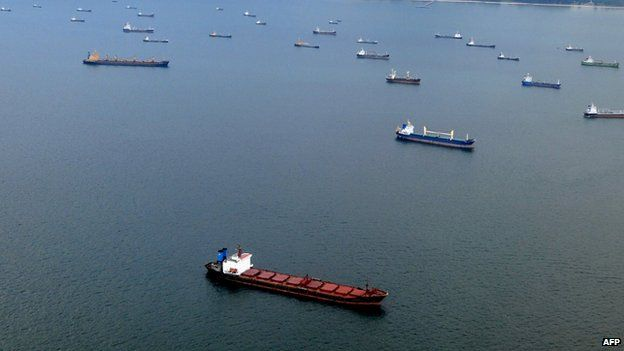 File photo: Ships anchored off Singapore's coastline