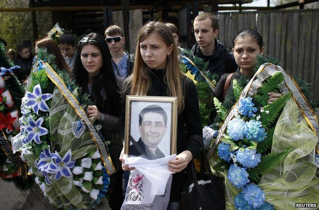 Mourners at the funeral of Volodymyr Rybak in Horlivka, Ukraine, 24 April
