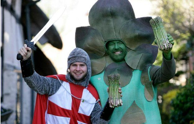 Man dressed as an asparagus and another one dressed as St George