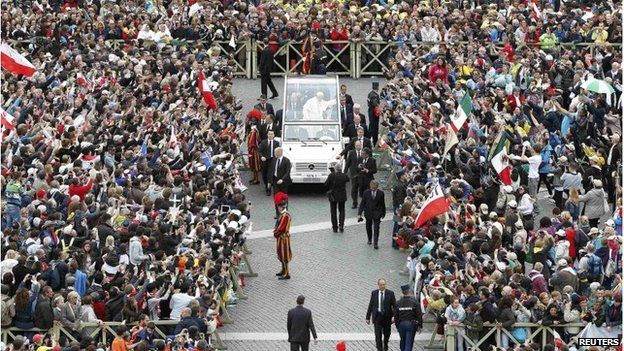 Pope Francis greets the faithful n St Peter's Square at the Vatican April 27