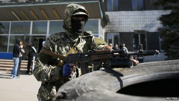 A pro-Russian armed man holds his weapon in front of the seized town administration building in Kostyantynivka April 28, 2014