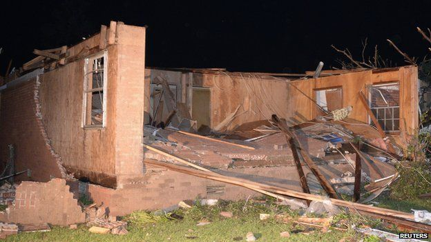 A damaged house is seen after a tornado hit the town of Mayflower, Arkansas, on 27 April