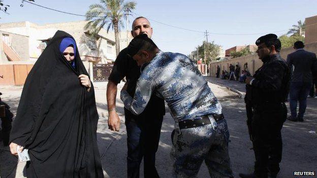 Voters frisked in Baghdad, 30 April