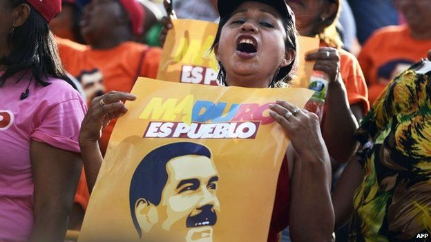 Supporters of Venezuelan President Nicolas Maduro are seen during an event celebrating his first year of government at Miraflores presidential palace in Caracas on 15 April 15, 2014
