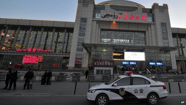 Chinese police men guard the entrance to the Urumqi South Railway Station in Urumqi in northwest China's Xinjiang Uighur Autonomous Region 30 April 2014