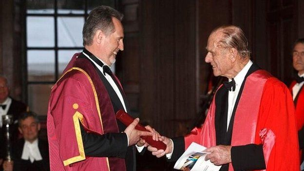 File photo of Dmytro Firtash (L) with the Duke of Edinburgh at Cambridge University