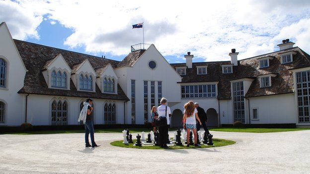 Dotcom Mansion with people playing chess outside