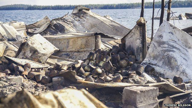 Wreckage and burned cans after fire at a warehouse containing rotting fish in Sweden