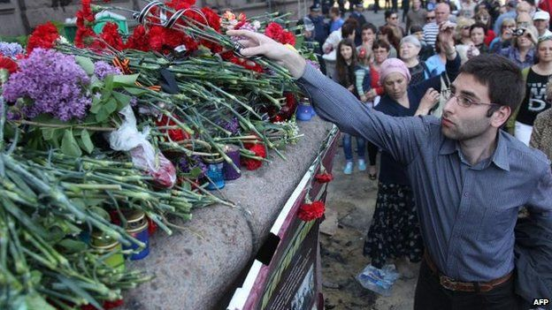 Flowers are left at the burned building in Odessa, 3 May