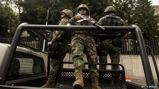 Mexican Navy marines patrol in a truck on 16 July, 2013