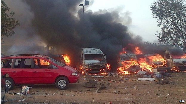 Vehicles burn after an attack in Abuja on 14 April 2014