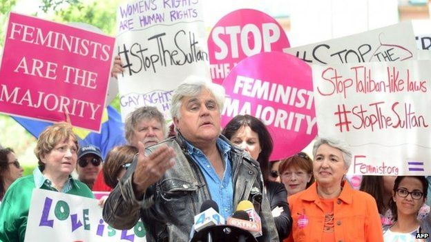 Jay Leno speaks at a gathering of Women's Rights and LGBT groups protesting across from the Beverly Hills Hotel, 5 May 2014