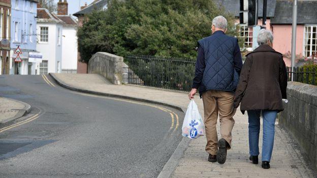 Couple walking across bridge in Christchurch