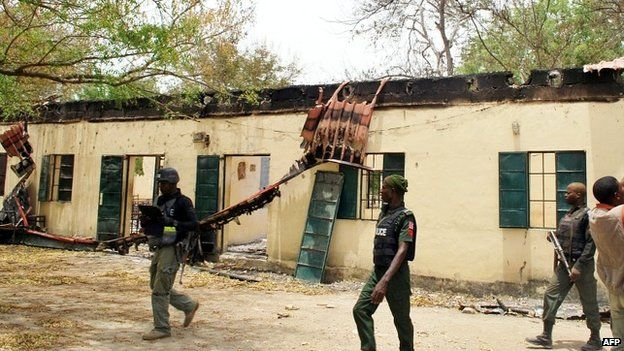 Police officers walk past the Chibok school where the schoolgirls were abducted - 21 April 2014