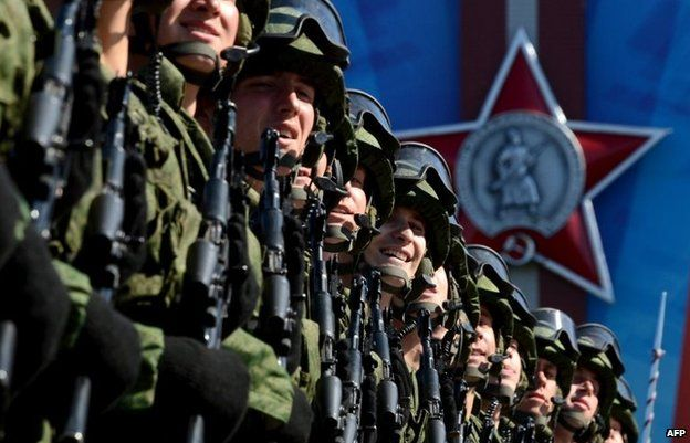 Russian soldiers march at the Red Square in Moscow, on May 9