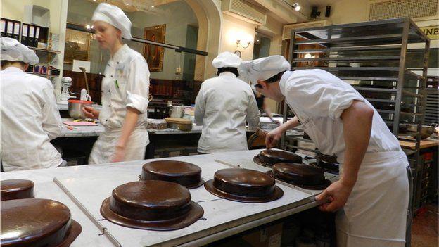 Sachertorte cakes being made at Demel