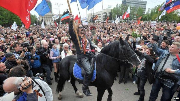 A pro-Russia activist marks the anniversary in the eastern city of Donetsk, 9 May