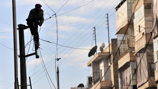 Man fixing electricity in Aleppo (file photo)