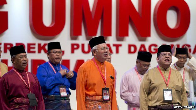 Malaysian Prime Minister Najib Razak with party members at the national assembly in Kuala Lumpur