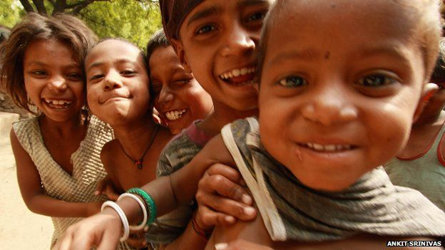 Five young children smiling at the camera