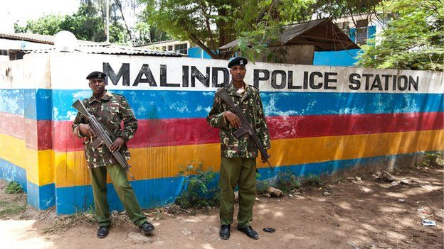 Two officers stand guard outside the Malindi police station in Kenya on 28 March 2013
