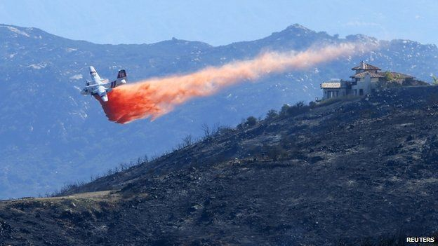 A water bomber made a drop in San Marcos California, on 15 May 2014