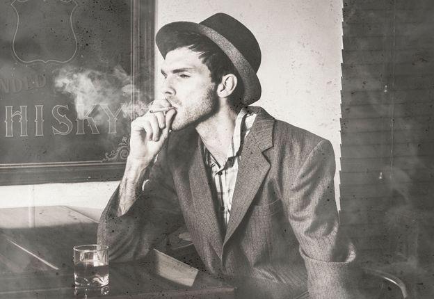 Man at bar smoking
