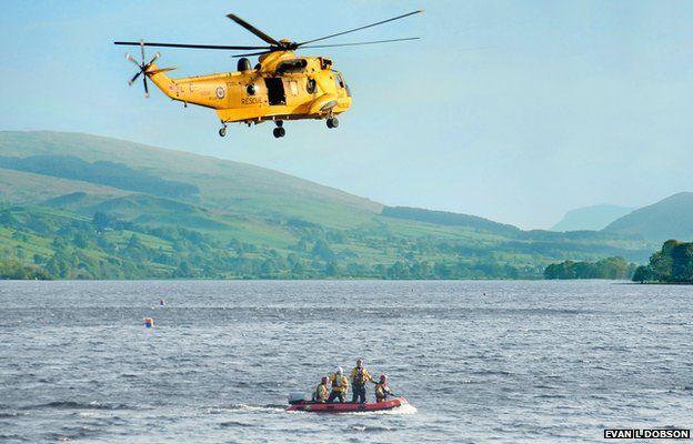 RAF Valley Sea King hovers above search team on Llyn Tegid, Bala, Gwynedd. PIC EVAN L DOBSON