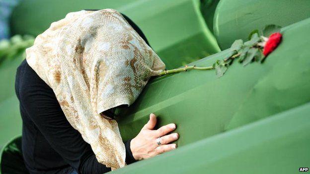 Survivor of 1995 massacre mourns a relative at memorial cemetery in Srebrenica