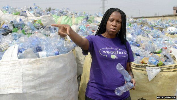 Bilikiss Adebiyi-Abiola in front of bags of plastic bottles