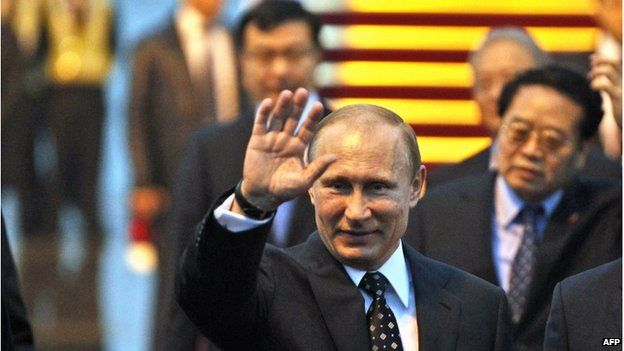 Russia's President Vladimir Putin arrives for the fourth summit of the Conference on Interaction and Confidence Building Measures in Asia (CICA) held in Shanghai on 20 May.