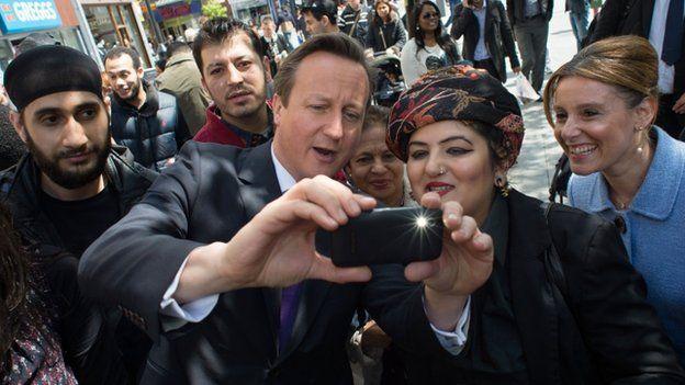 "David Cameron takes a ""selfie"" as he meets local people in Harrow"