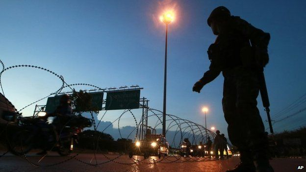 Thai soldiers man a checkpoint in Bangkok, 20 May
